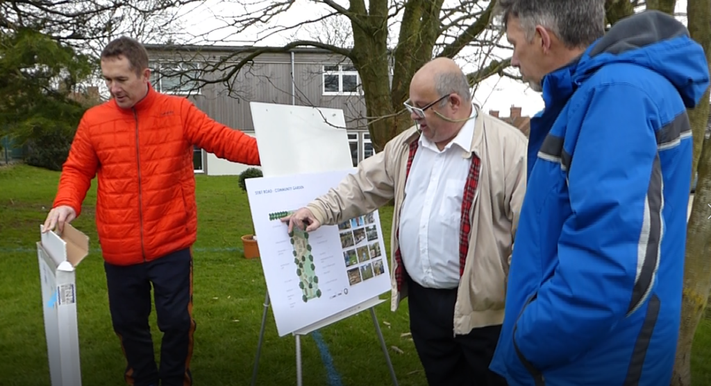 Residents view a scale model of the proposed Community Garden